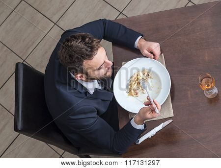 Man Eating Penne Pasta