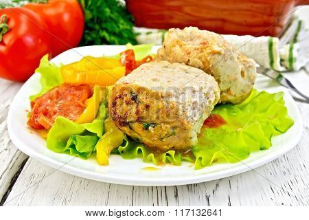 Cutlets of turkey with vegetables in plate on board