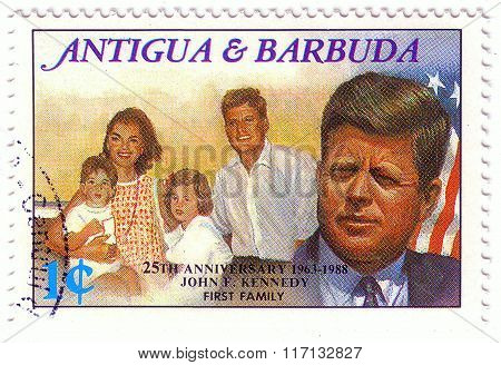 Antigua And Barbuda- Circa 1988: Stamp Printed By Antigua And Barbuda, Shows John Kennedy And His Fa