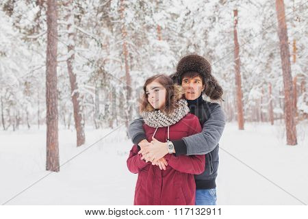 Happy Young Couple in Winter Park having fun.Family Outdoors. love, valentine day