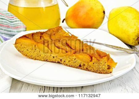 Pie with pears and honey in plate on board