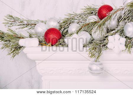 Christmas balls on fireplace