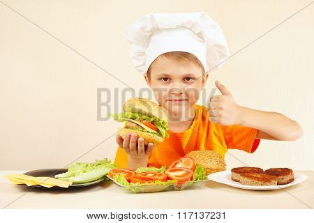 Little funny chef expressive enjoys cooked hamburger