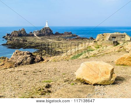 La Corbiere Lighthouse On The Rocky Coast Of Jersey Island