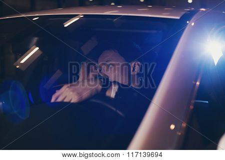 Asian Man In Car Doing His Hair.