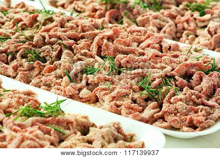 Trays Of Breaded Strips Of Raw Beef
