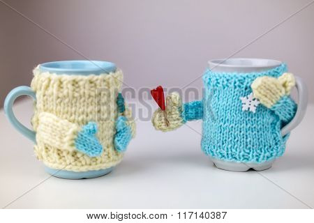 Cups in sweater.