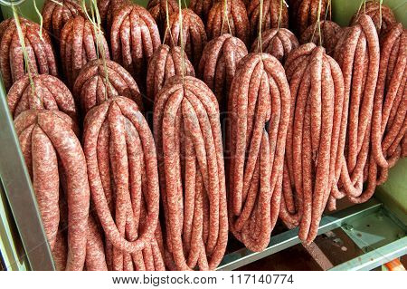 Assorted Sausages Hanging In A Butchery
