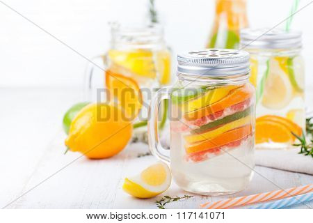 Detox fruit infused flavored water. Refreshing summer homemade lemonade cocktail Cleanse body and bu