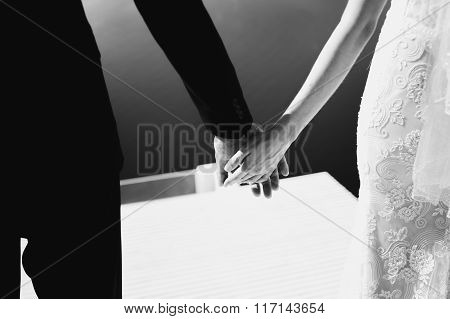 Romantic Beautiful Couple Holding Hands On Terrace With Sea In Background Closeup B&w