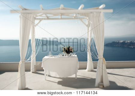Beatiful Elegant Wedding Tent Aisle At Coast With Sea And Mountains Background