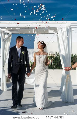 Newlywed Wife And Husband Walking From Wedding Aisle Sky Background