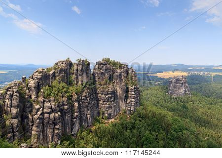 Panorama With Group Of Rocks Schrammsteine And Falkenstein Seen From Viewing Point In Saxon Switzerl