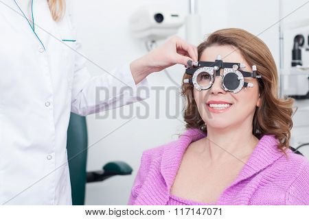 Skillful ophthalmologist with equipment for lens determination