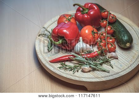 Fresh Vegetables. Top View Of Red Ripe Tomatoes And Cucumber On Wooden Table.