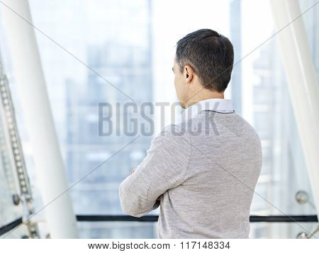 Business Person Thinking By The Windows
