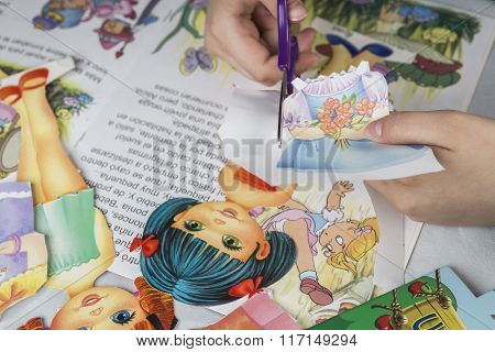 Girl Cutting Paper Doll