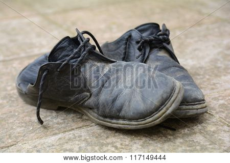 Dirty and damaged old shoes