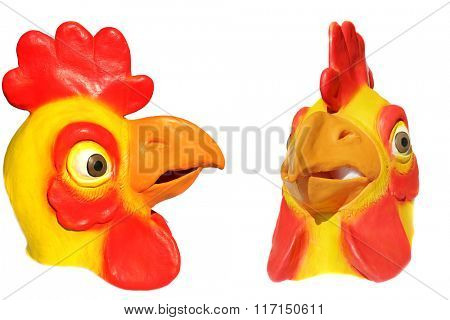 Generic Rubber Yellow and Red Chicken Head Mask. Isolated on white with room for your text.