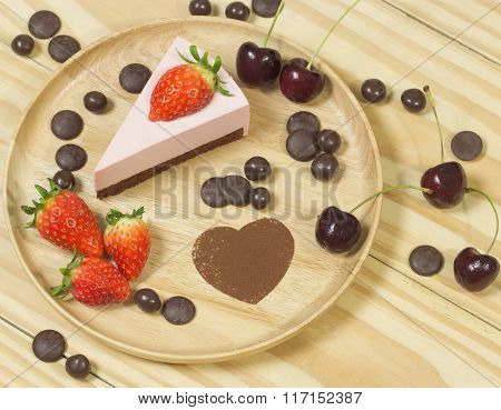 Selective Focus Of Strawberry Chocolate Cheese Cakeon Wood Background With Strawberry And Chocolate