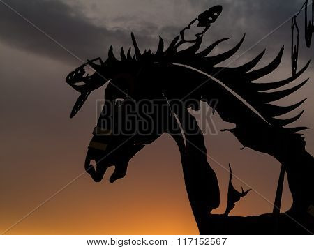 Horse Head Sculpture At Sunset