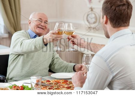 Cheerful family is celebrating with alcohol drink