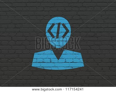 Programming concept: Programmer on wall background