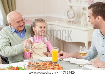 Pretty friendly family has a dinner with joy