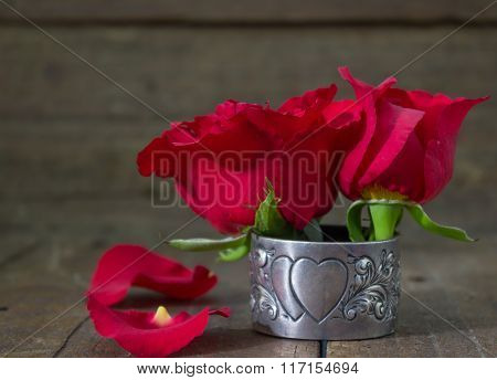 Red Roses On Old Table In Antique Silver Heart Serviette Holder