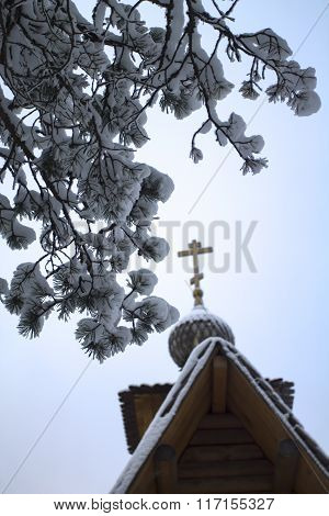 Wooden Christian Church With Cross And Pine Branch In Snow