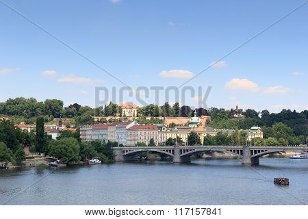 Manes Bridge And Boats On River Vltava In Prague