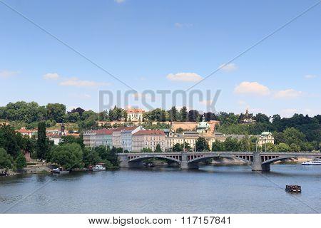 Manes Bridge And Boats On River Vltava In Prague