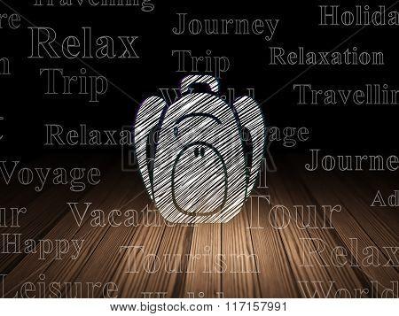Tourism concept: Backpack in grunge dark room