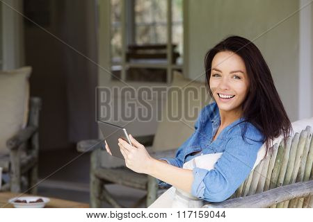 Attractive Young Lady Relaxing With Touch Screen Tablet