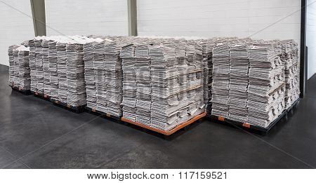 Many Newspaper Stacks On Pallets