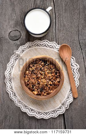 Granola In Wooden Bowl And Milk