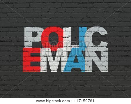 Law concept: Policeman on wall background