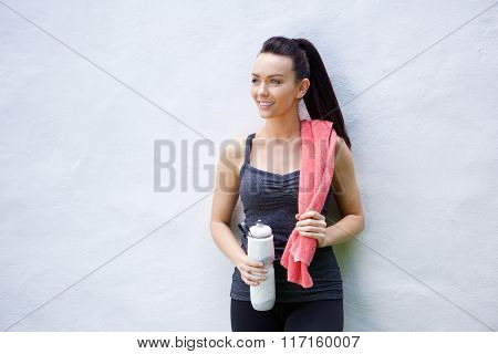 Young Woman With Towel And Water Bottle After Workout
