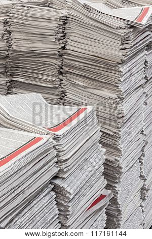 Vertical Close Up Of Newspaper Stacks