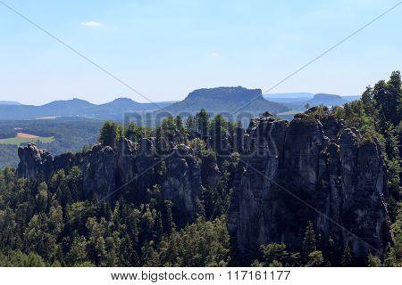 Panorama With Rocks Bastei, Neurathen Castle And Table Mountain Lilienstein In Rathen, Saxon Switzer