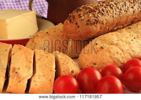 Cereal Baguette With Tomatoes And Butter