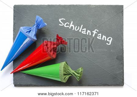 School Cones On A  Chartboard With German Message Schulanfang