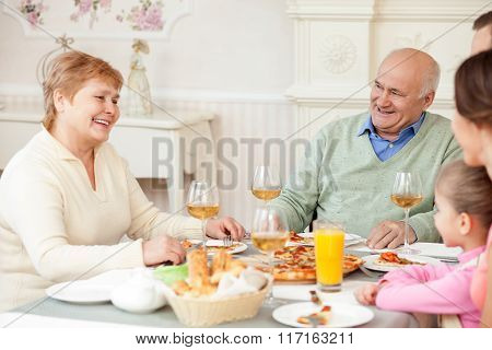 Cute friendly family is spending time together
