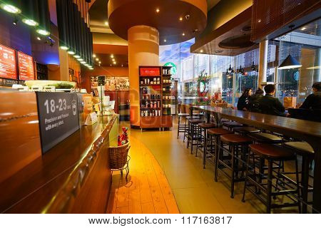 SHENZHEN, CHINA - FEBRUARY 05, 2016: interior of Starbucks Cafe. Starbucks Corporation is an American global coffee company and coffeehouse chain based in Seattle, Washington