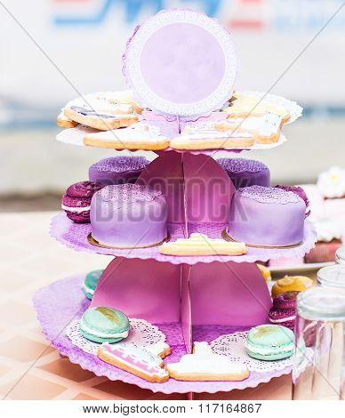 Delicious and tasty dessert table with cupcakes