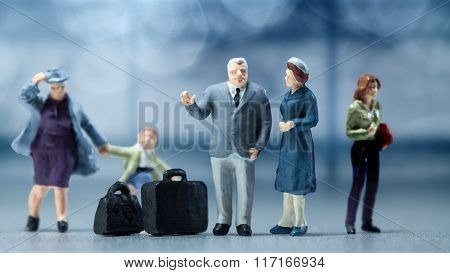 Miniature people - people waiting in the airport lobby