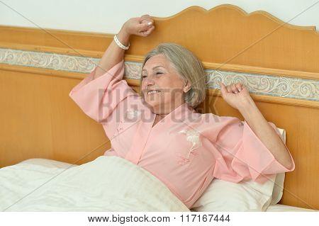 Elderly female  resting in bed