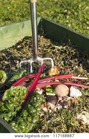 Image of garden fork in a compost bin