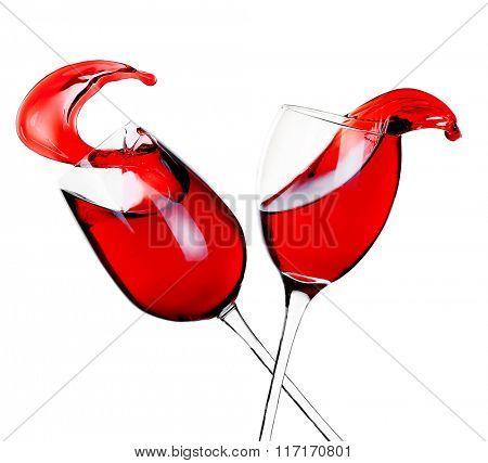 Glasses of red wine with splash, isolated on white