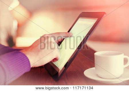 Young man using his tablet-pc, close up